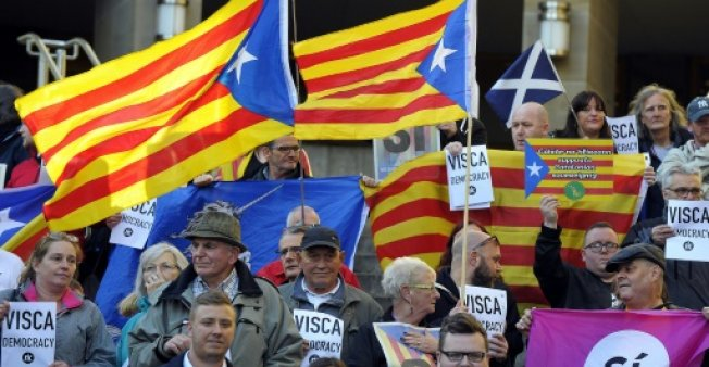 Catalan police warn of public disorder if polling stations closed