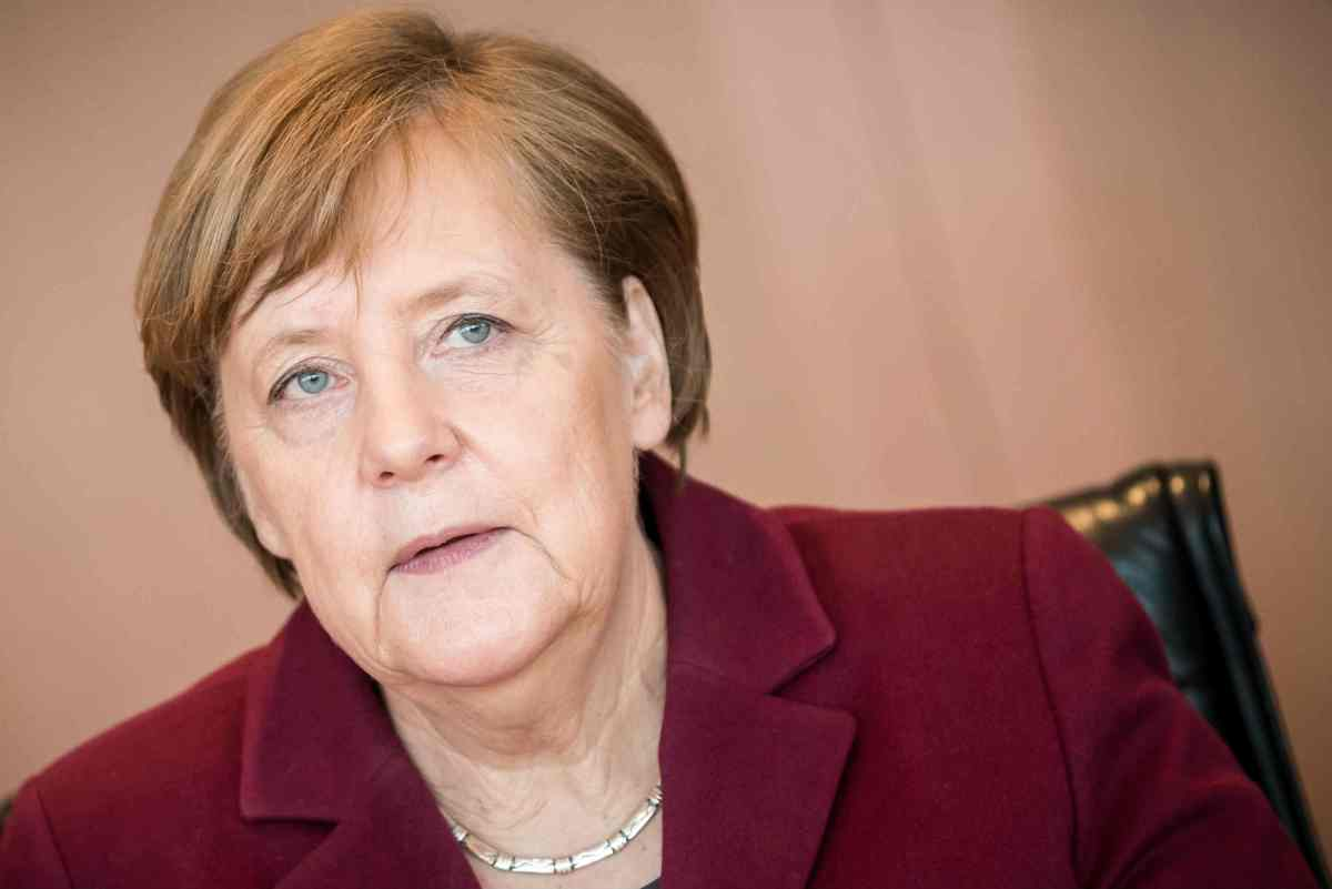 Weakened Merkel wins fourth term, hit by nationalist 'earthquake'